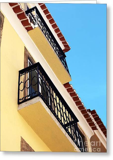 Yellow House In Alfama Greeting Card by John Rizzuto