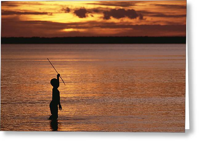 Young Boy Spear Fishing At Sunset Greeting Card