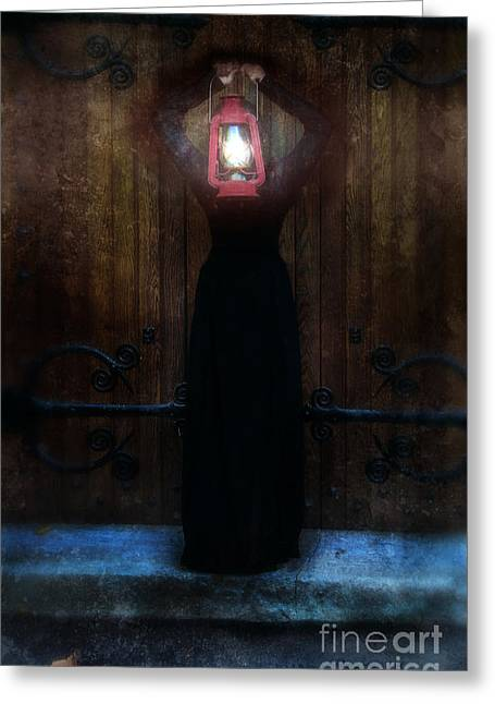 Young Woman In Black Lantern In Front Of Her Face Greeting Card by Jill Battaglia