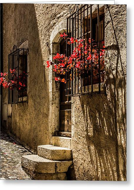 A Barred Window And Door With Red Begonia And Contrasty Shadows Saint Paul De Vence France Greeting Card