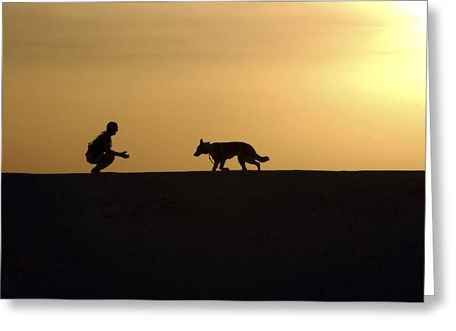 A Military Working Dog And His Handler Greeting Card by Stocktrek Images