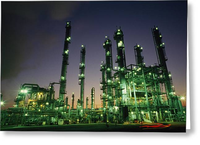 Twilight Views Greeting Cards - An Oil Refinery At Dusk Greeting Card by Lynn Johnson