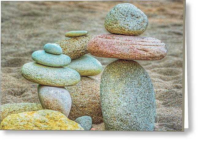 Stacked Rocks On Sandy Beach Greeting Card