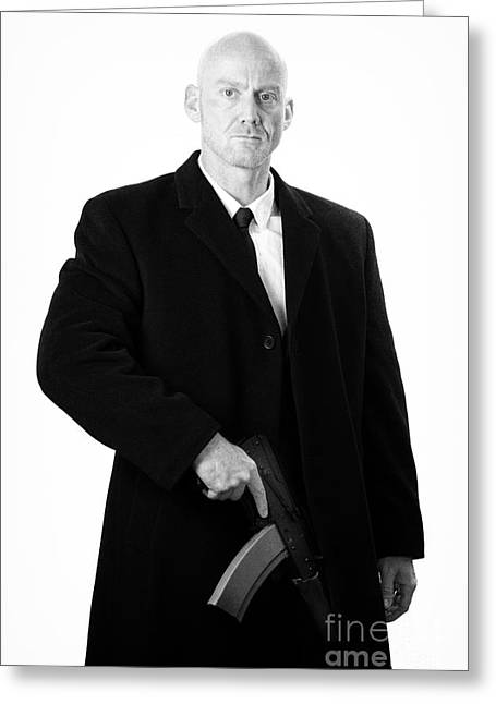 Bald Headed Man Wearing Heavy Black Overcoat Holding Ak-47 Greeting Card by Joe Fox