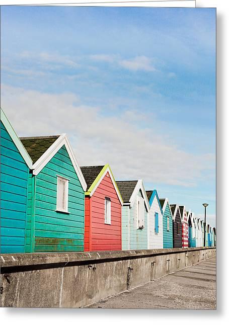 Beach Huts Greeting Card by Tom Gowanlock