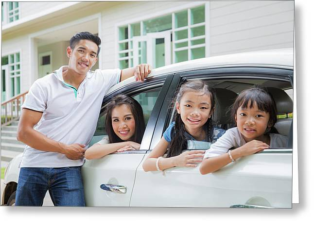 Beautiful Family Portrait Smiling Outside Their New House  Greeting Card by Anek Suwannaphoom