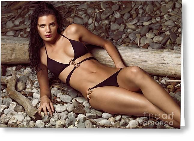 Beautiful Young Woman In Black Bikini On A Pebble Beach Greeting Card by Oleksiy Maksymenko