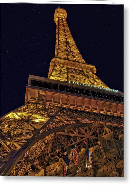 Beneath The Eiffel Tower Greeting Card by Susan Candelario