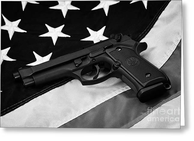 Beretta Handgun Lying On United States Of America Flag Greeting Card by Joe Fox