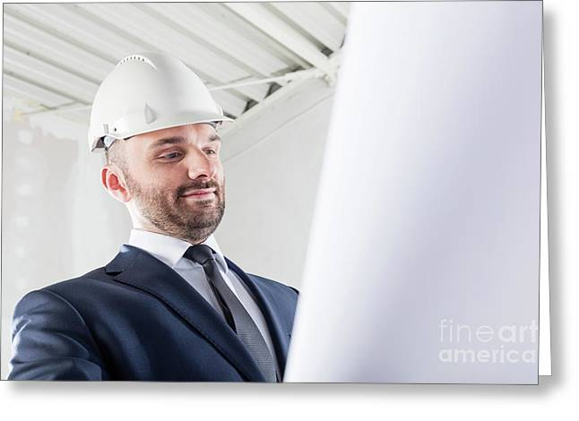 Businessman Reading Documents At The Construction Site. Greeting Card
