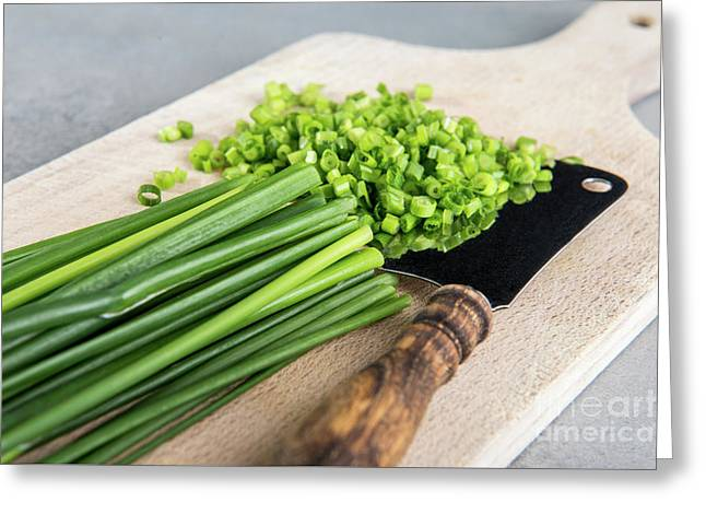 Chopped Chives On Cutting Board Greeting Card by Piotr Marcinski