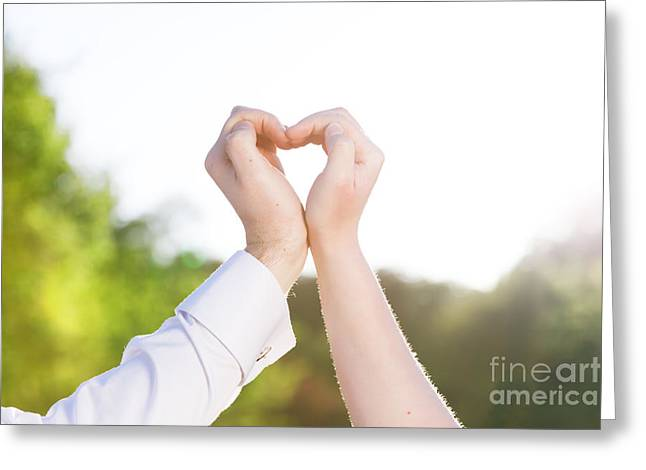 Couple In Love Making A Heart Shape With Their Hands Outdoors Greeting Card by Michal Bednarek