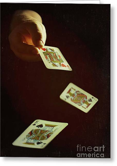 Dealing The Cards Greeting Card by Amanda Elwell
