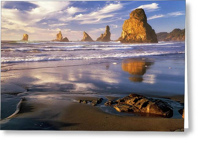 Evening Glow On The Sea Stacks At Remote China Beach In Oregon's Boardman State Park. Greeting Card by Larry Geddis