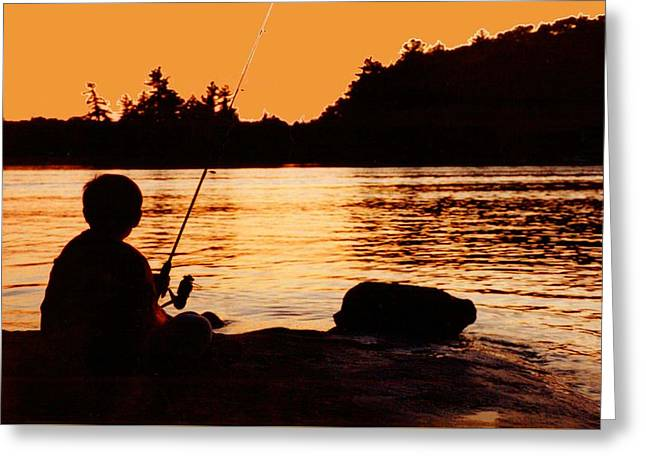 Fishing From A Rock  Greeting Card by Lyle Crump