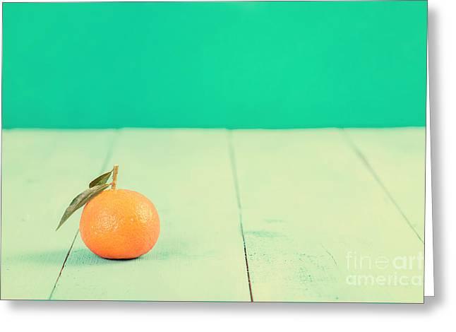 Fresh Tangerine On Blue Table Greeting Card