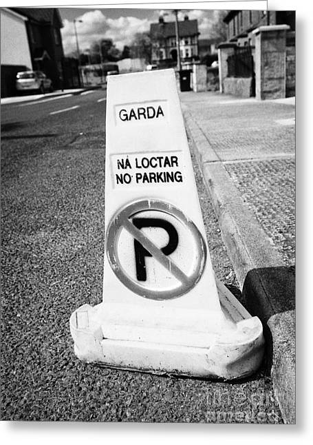 garda no parking traffic cones on a street in Clones county monaghan republic of ireland Greeting Card
