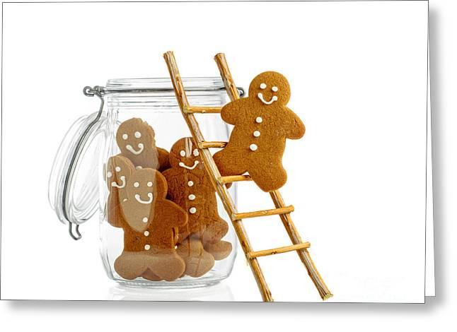 Gingerbread Men Greeting Card by Amanda Elwell