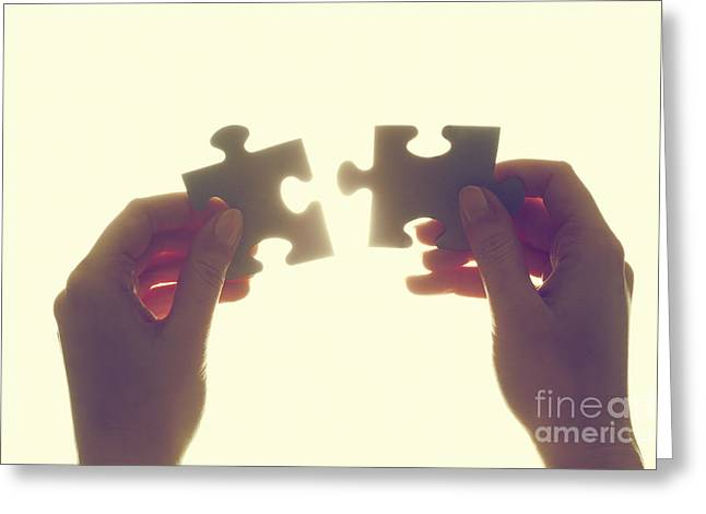 Joining Two Pieces Of Jigsaw Puzzle Greeting Card by Michal Bednarek
