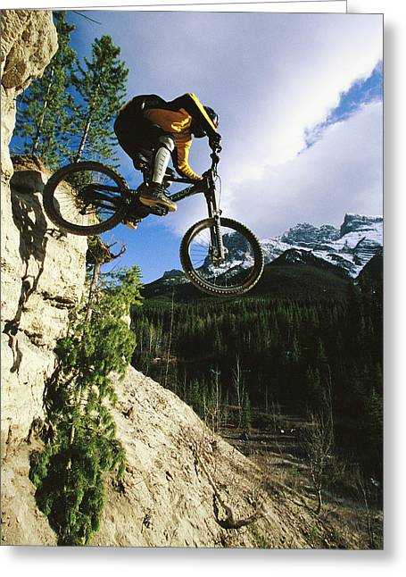 Release Greeting Cards - Man Jumping On His Mountain Bike Greeting Card by Mark Cosslett