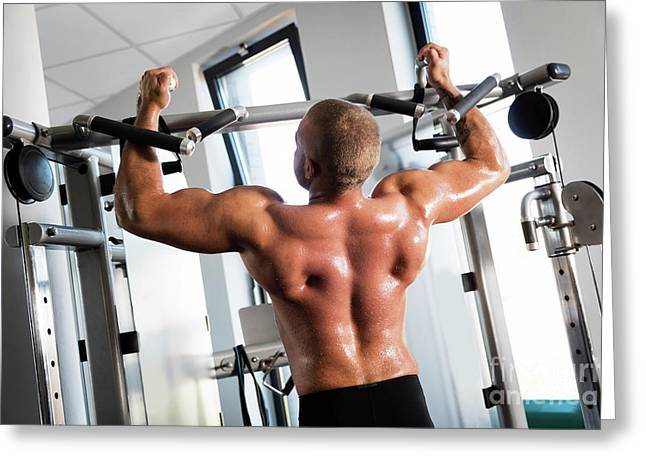 Muscular Strong Man Working Out At A Gym. Greeting Card