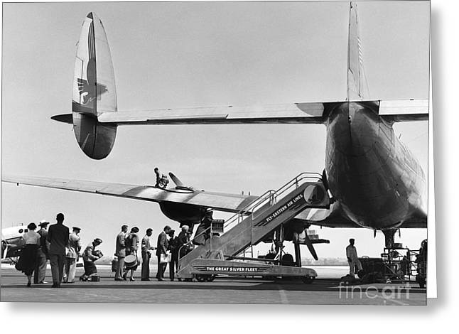 Passengers Boarding A Plane Greeting Card by C.S. Bauer/ClassicStock