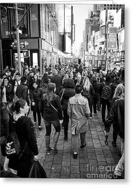 people crossing crosswalk full busy sidewalk in the evening evening in Times Square New York City US Greeting Card