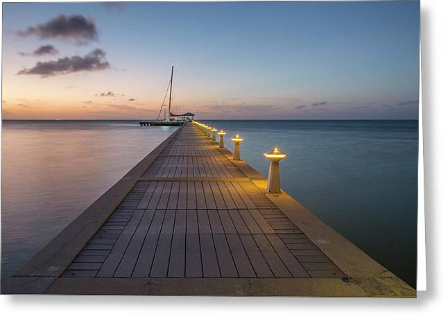 Greeting Card featuring the photograph Rum Point Pier At Sunset by Adam Romanowicz