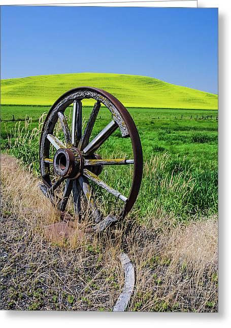 Rustic Wagon Wheel In The Palouse Greeting Card by James Hammond