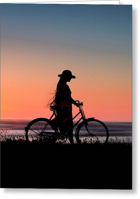 Silhouette Of Girl And Bike At Sunset Near The Sea. Greeting Card