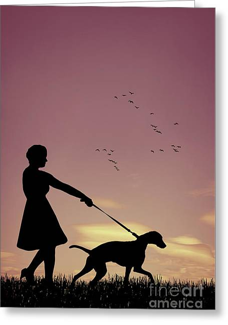 Silhouette Of Woman Walking Her Dog Greeting Card by Amanda Elwell