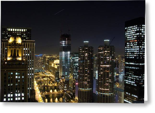 Skyscrapers In A City Lit Up At Night Greeting Card by Panoramic Images