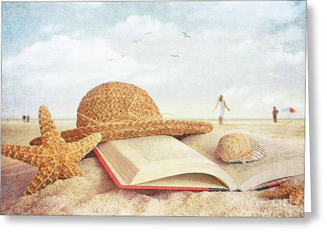 Straw Hat Book And Seashells In The Sand Greeting Card