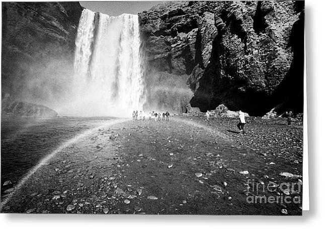 Tourists And Double Rainbow At Skogafoss Waterfall In Iceland Greeting Card by Joe Fox