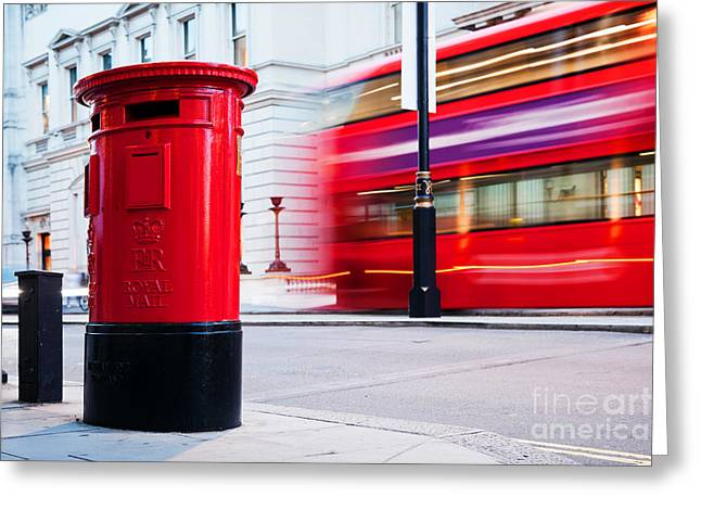 Traditional Red Mail Letter Box And Red Bus In Motion In London, The Uk Greeting Card by Michal Bednarek