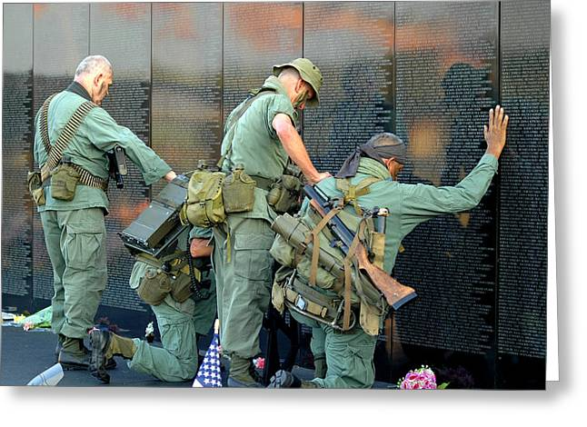 Greeting Card featuring the photograph Veterans At Vietnam Wall by Carolyn Marshall