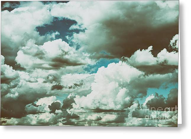 White Cumulus Clouds And Grey Storm Clouds Gathering On Blue Sky Greeting Card by Radu Bercan