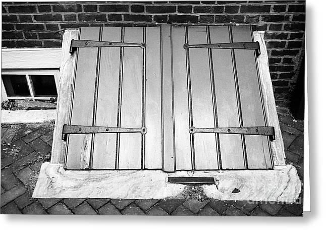 wooden door access to basement in elfreths alley in the old city of Philadelphia USA Greeting Card