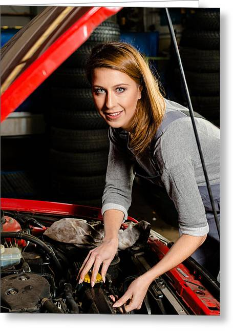 Young Female Trainee Fixing Car Engine In Garage Greeting Card by Frank Gaertner