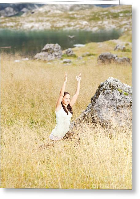 Young Woman Doing Yoga Exercises In High Grass Greeting Card by Wolfgang Steiner