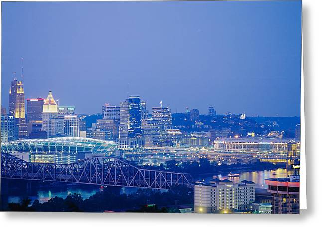 Buildings In A City Lit Up At Dusk Greeting Card by Panoramic Images