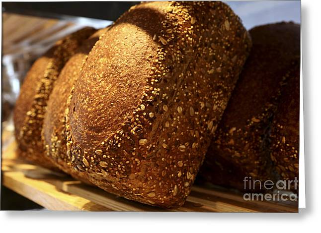 Freshly Baked Loaves Of Bread At A Bakery Greeting Card by Oren Shalev