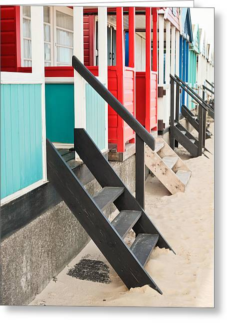 Beach Huts Greeting Card by Tom Gowanlock
