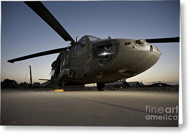 A Uh-60l Blackhawk Parked On Its Pad Greeting Card by Terry Moore