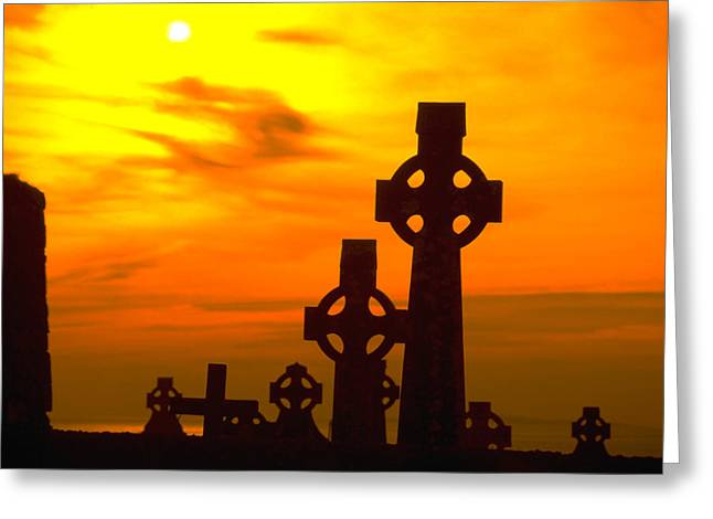 Celtic Crosses In Sunset Greeting Card by Carl Purcell