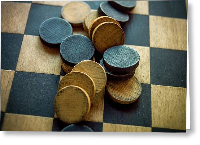 Checkers On A Checkerboard Greeting Card by Bernard Jaubert