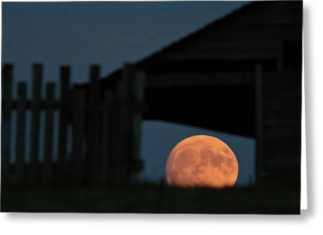 Prairie Sky Art Greeting Cards - Full moon seen through old building window Greeting Card by Mark Duffy