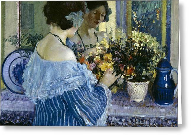 Girl In Blue Arranging Flowers Greeting Card by Frederick Carl Frieseke