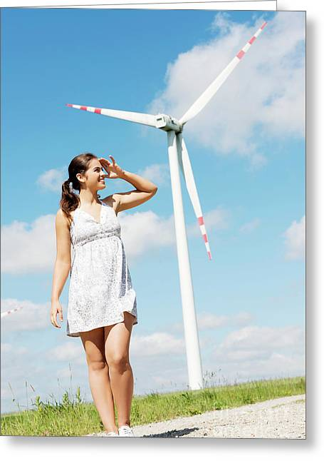 Happy Teen Girl Next To Wind Turbine. Greeting Card by Piotr Marcinski