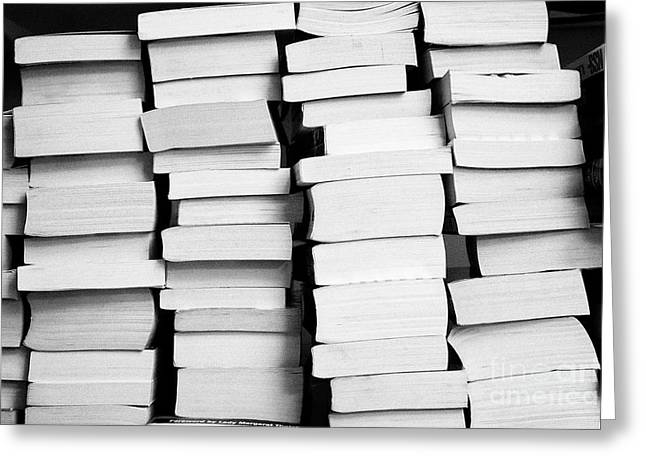 Pile Of Stacks Of Used Paperback Books In The Uk Greeting Card by Joe Fox